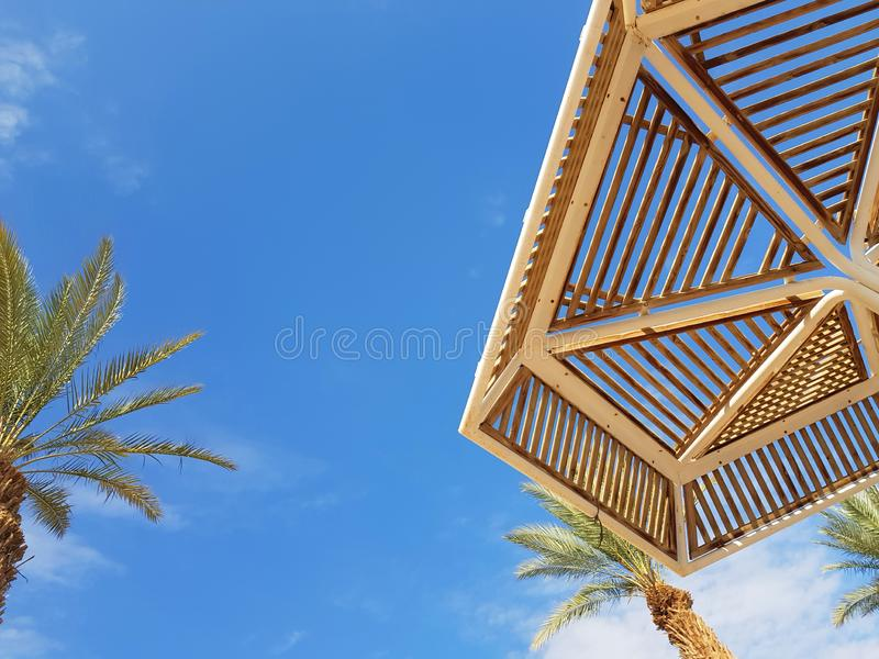 Clear sunny sky and beach umbrellas in Eilat resort; Israel. Sunny sky and beach umbrellas in Eilat resort; Israel stock image