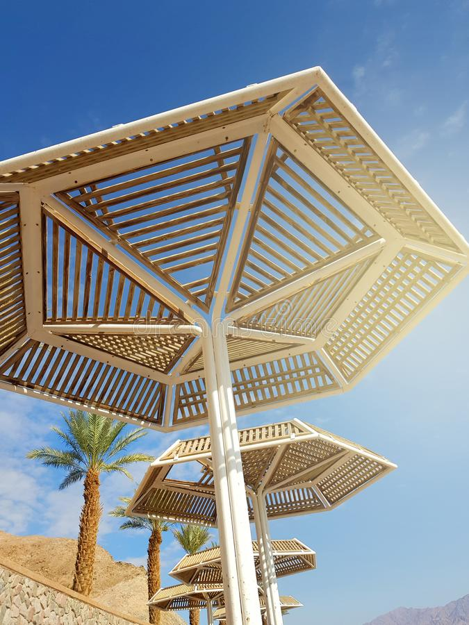 Clear sunny sky and beach umbrellas in Eilat resort; Israel. Sunny sky and beach umbrellas in Eilat resort; Israel stock photography