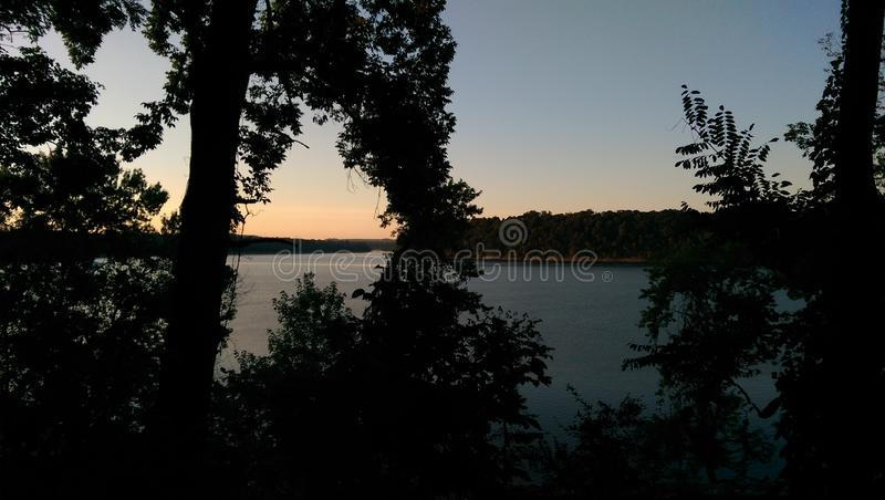 Clear sunset over the lake royalty free stock photos