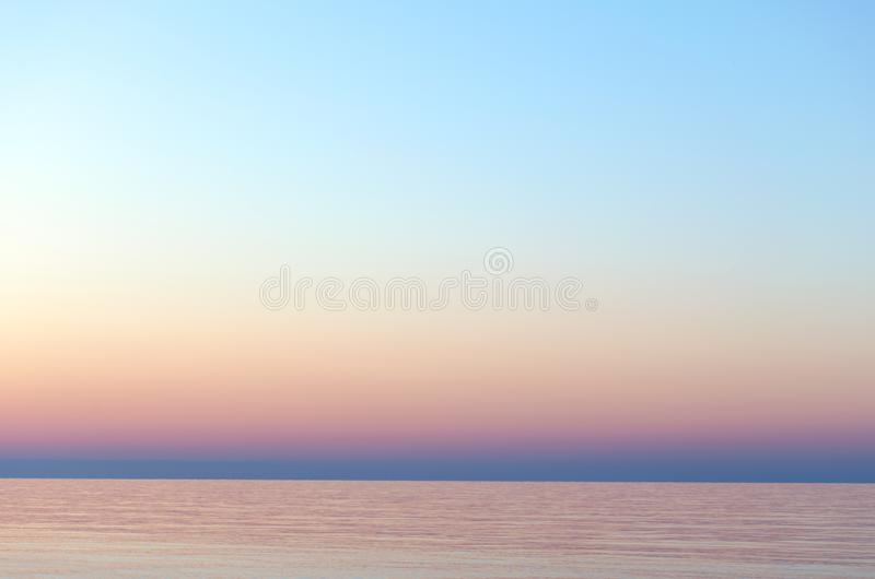 Clear sunset sky. Gradient background in pastel colors. Sunset over the sea. Beach dawn. Light nature exposure royalty free stock image