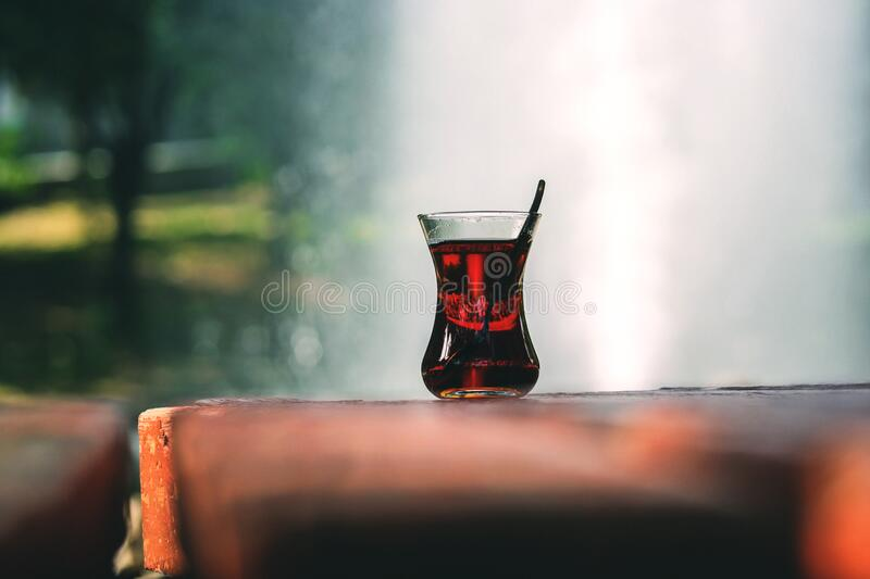 Clear Turkey Tea Glass With Tea On Brown Wooden Table Free Public Domain Cc0 Image