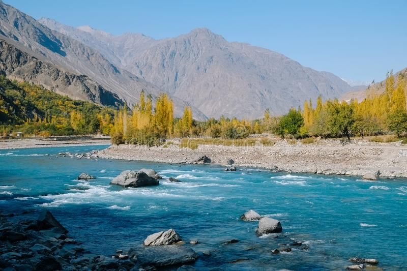 River flowing along mountain range in autumn royalty free stock photography