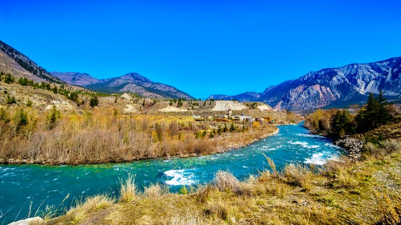 Cayoosh Creek just before it runs into the Fraser River in British Columbia, Canada. The clear turquoise waters of the Cayoosh Creek just before it runs into the royalty free stock image