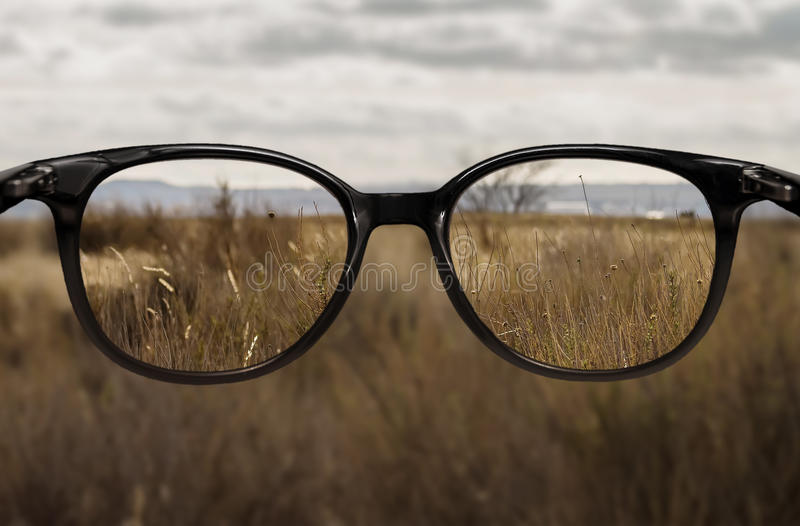 Clear vision through glasses stock photos