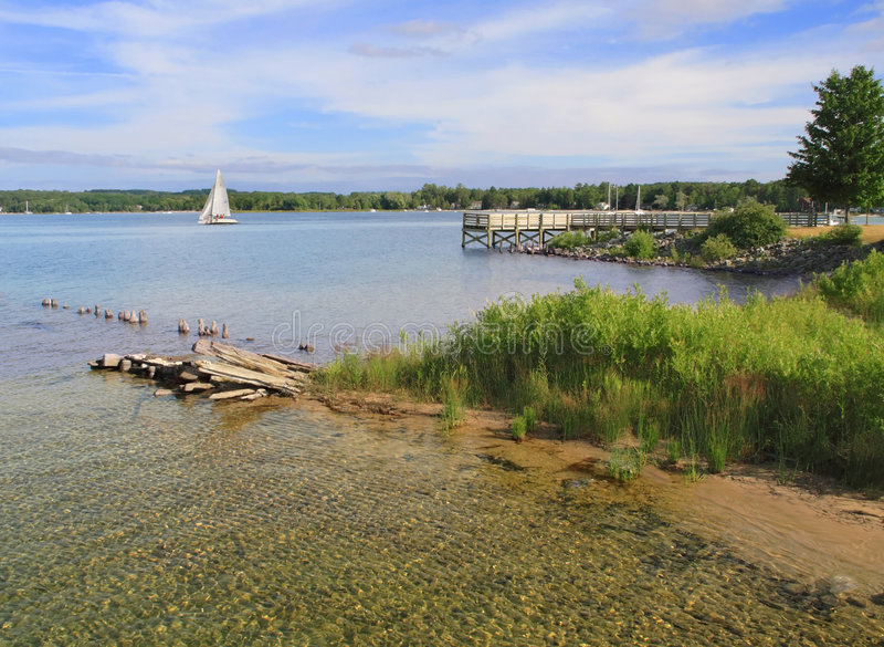 Download Clear water and blue sky stock image. Image of leelanau - 1097189