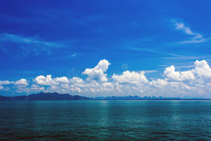 Clear water and blue sky. Accessibility backgrounds beautiful beauty bright climate cloud cloudscape colors copy danger dark deep empty freedom horizon light royalty free stock photography