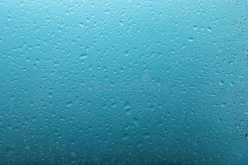 Clear water drops on light blue surface. Clear water drops on light blue stock photography