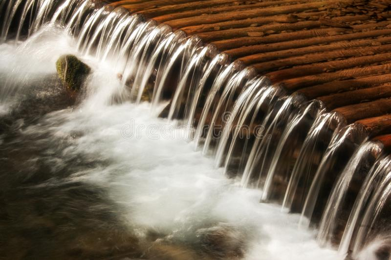 Clear water of a mountain river in a cascade waterfall in the Carpathians. Concept - environmental protection and stock image