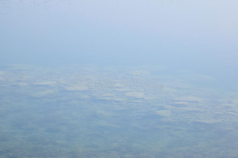 Clear water of new lake named Milada in spring morning in Czech republic stock photo