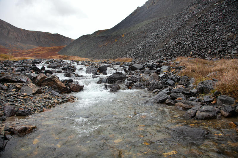 Clear water in the rugged mountain river royalty free stock photography