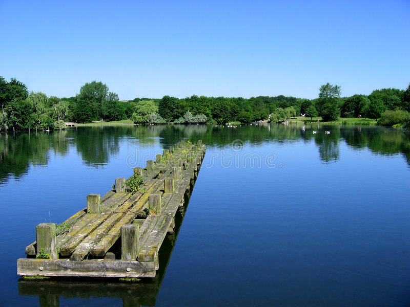 Clear water with sky and pier stock images