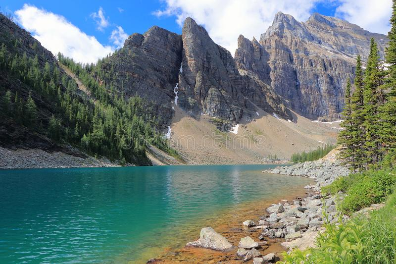 Beautiful Lake Agnes near Lake Louise in the Canadian Rocky Mountains, Banff National Park, Alberta, Canada. The clear waters of beautiful Lake Agnes, high above stock images
