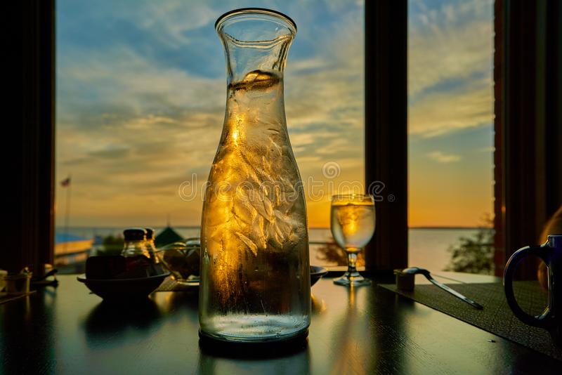 Clear Wine Glass and Clear Glass Pitcher stock image