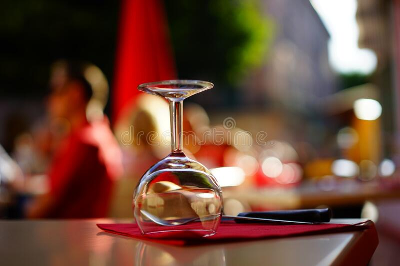 Clear Wine Glass on Top of Brown Table stock photo