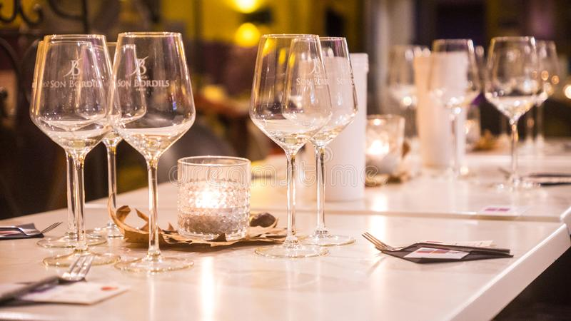 Clear Wine Glasses on White Wooden Table royalty free stock photography