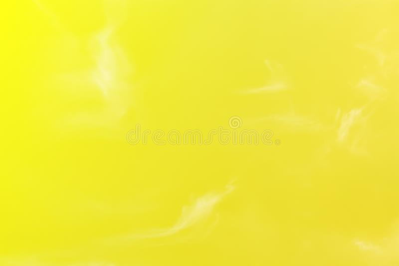 clear yellow sky and beautiful pattern white moving fluffy clouds stock image