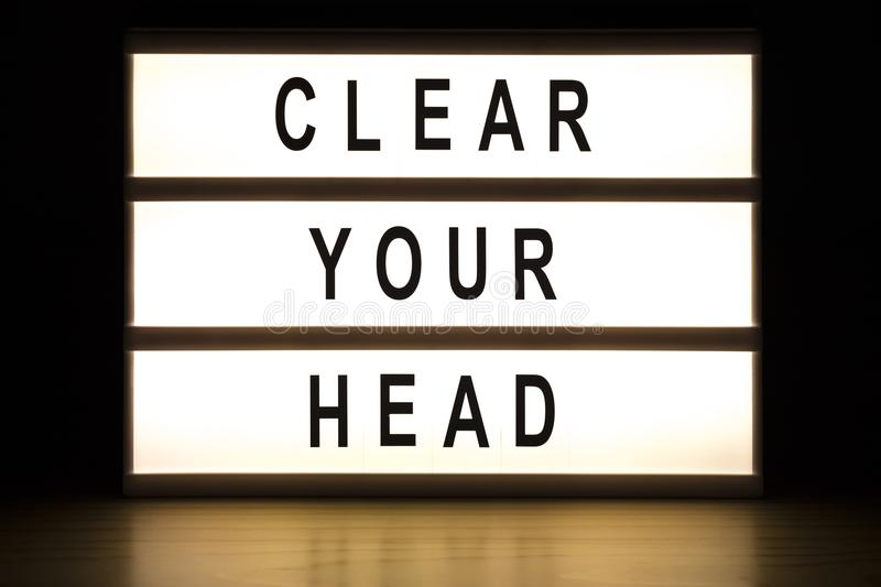 Clear your head light box sign board royalty free stock photography