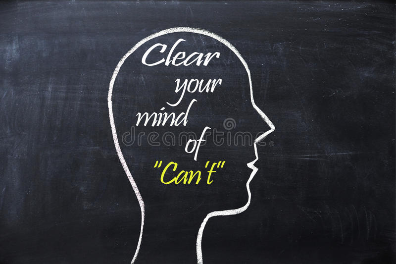 Clear your mind of can`t phrase inside human head shape drawn on chalkboard royalty free stock images