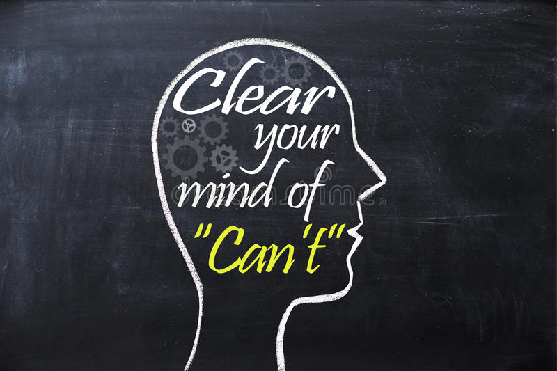 Clear your mind of can`t phrase inside human head shape drawn on chalkboard stock image