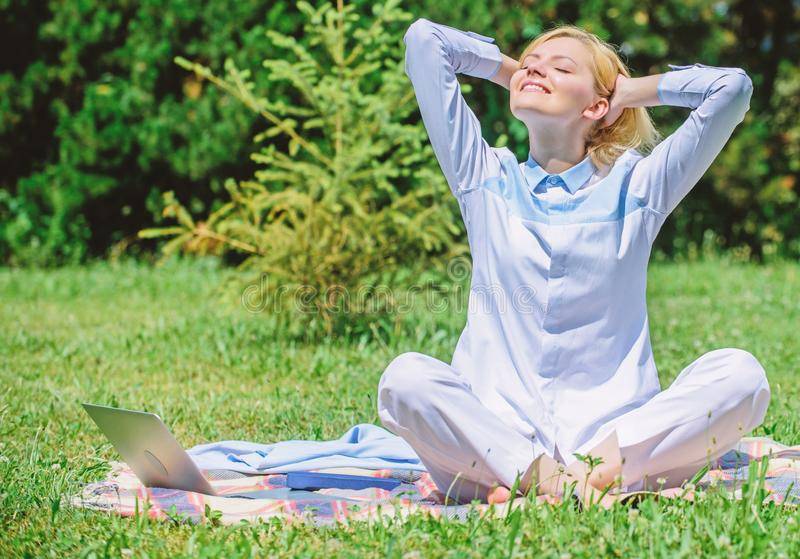 Clear your mind. Girl meditate on rug green grass meadow nature background. Find minute to relax. Woman relaxing. Practicing meditation. Every day meditation stock image
