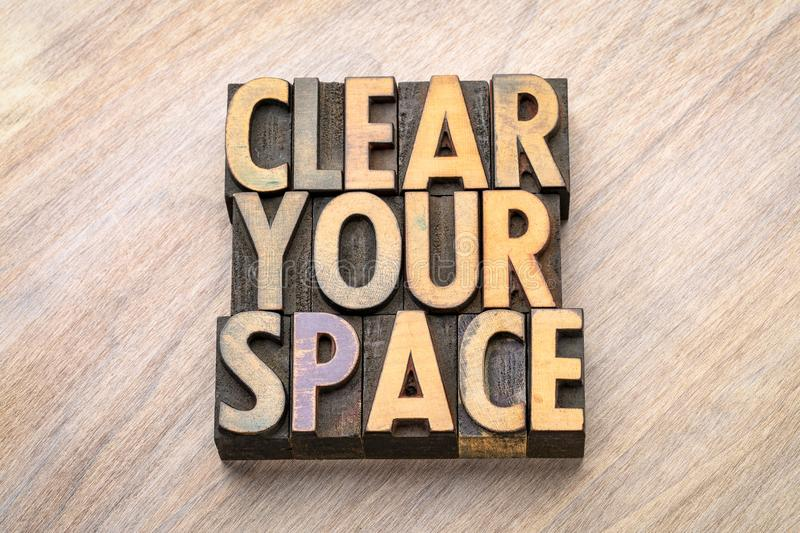 Clear your space - word abstract in wood type stock photos