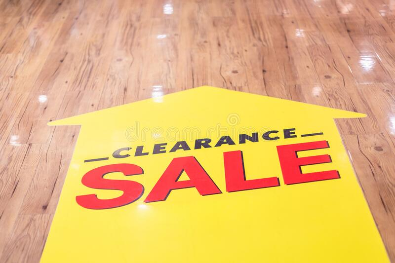CLEARANCE SALE sticker set up on the ground floor in fashion mall. Red CLEARANCE SALE sticker set up on the ground floor in fashion mall stock image