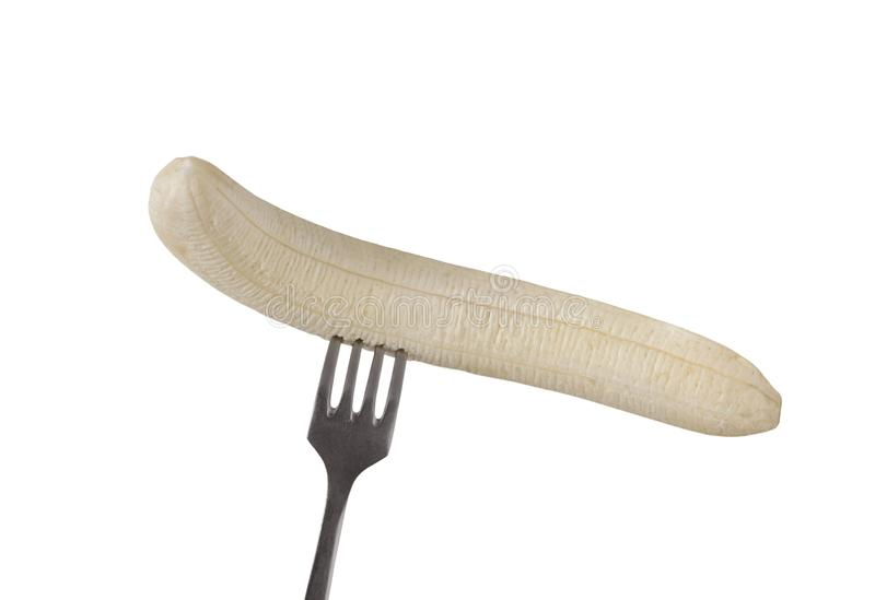 The cleared banana on a fork is isolated on a white background.  stock photo