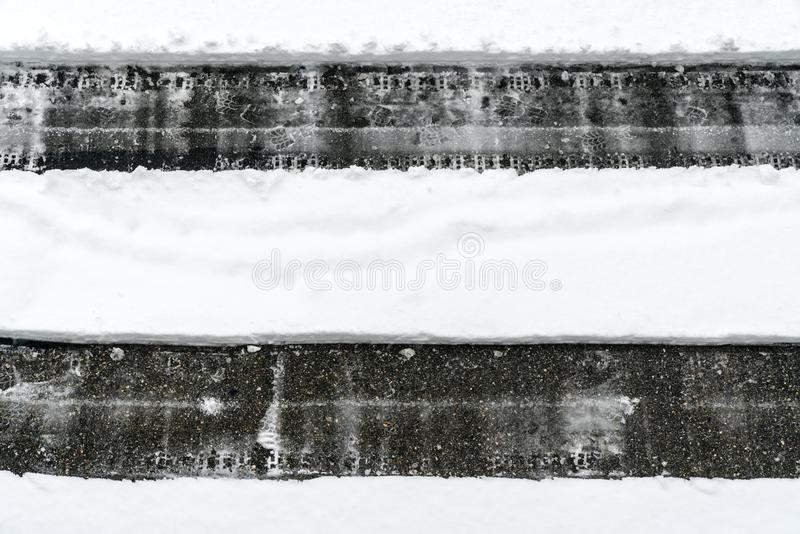Cleared path through deep snow on an asphalt road after a heavy snowfall. In winter in the Swiss Alps stock images