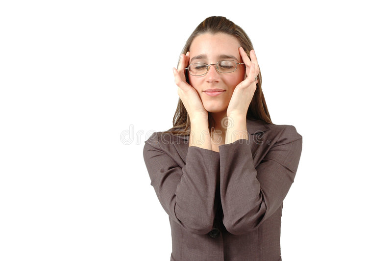 Clearing Head. Business woman takes a moment to rub her temples and clear her head royalty free stock image