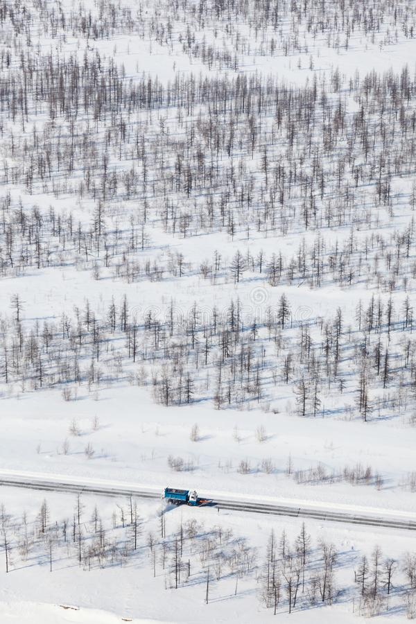 Clearing the road from the snow in the tundra, top view stock image