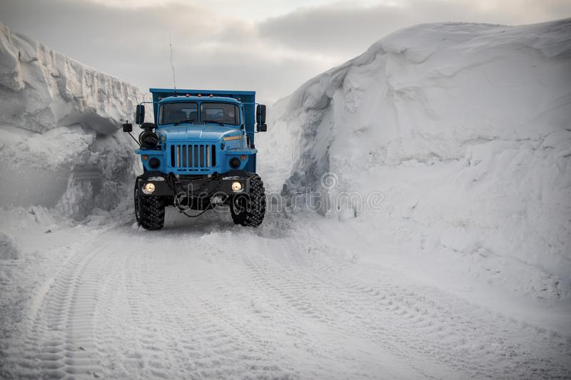 Snow removal in the Arctic. Clearing snow in the Arctic, dump trucks take it out royalty free stock photography