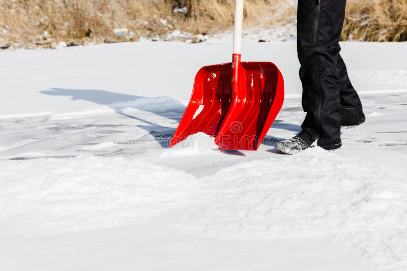 Clearing snow shovel stock images