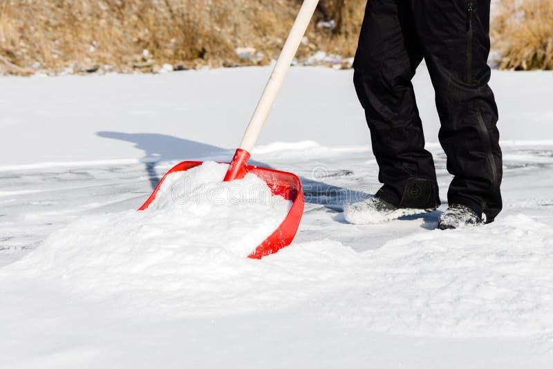 Clearing snow shovel royalty free stock photos