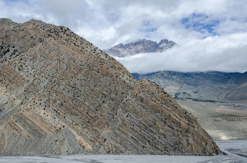 Clearly visible layered geological structure of Nepalese mountain. Near Jomsom town. Nepal stock photography