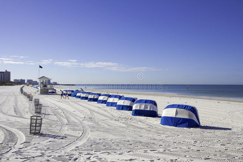 Clearwater Beach Morning. A beautiful morning on Clearwater Beach. The sky is blue and the sand is freshly raked royalty free stock photo