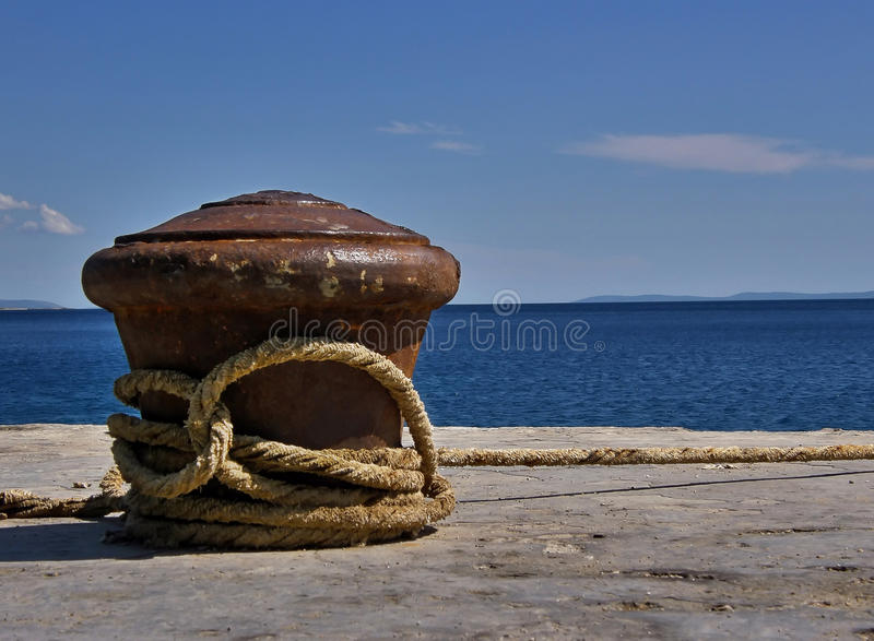 Cleat and rope at sea stock photography