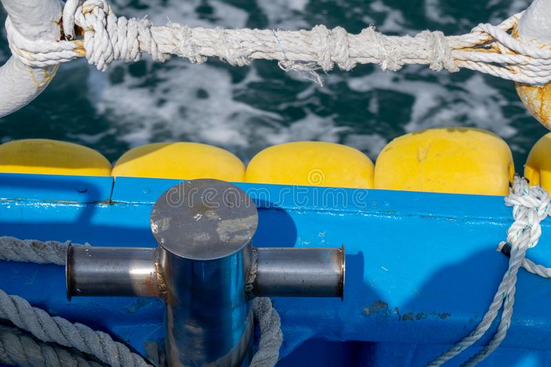 Cleat and safety fence rope on gunnel on board island ferry near coastalline in Geoje island, South Korea. stock photos