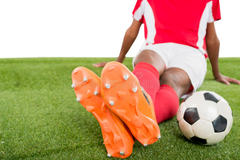 Cleats with studs. Close-up of orange cleats with spiked sole royalty free stock photo