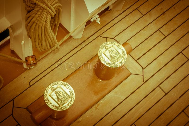 Cleats on the tall ship with seal. Rotterdam, Netherlands - August 08, 2017 : Tall ship b..a.p. Union of the peruvian navy was docked in Rotterdam. The seal of stock photos