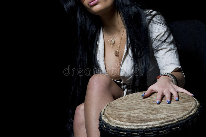 Cleavage and djembe. Girl, shirt, cleavage and djembe stock photo