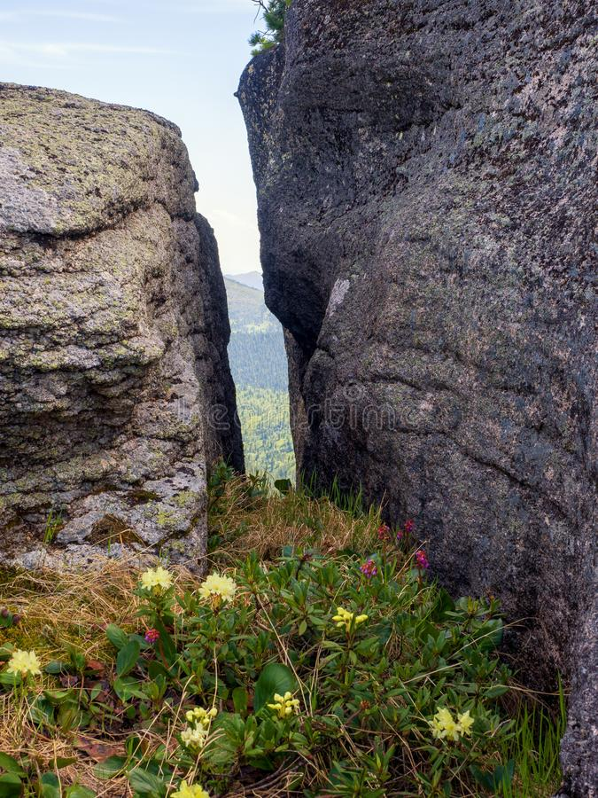 The cleft in the ancient stones in the Siberian natural park Ergaki. Mountains Western Sayan stock photography