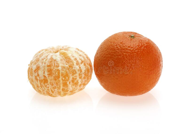 CLEMENTINE. FRUIT citrus reticulata AGAINST WHITE BACKGROUND royalty free stock photos