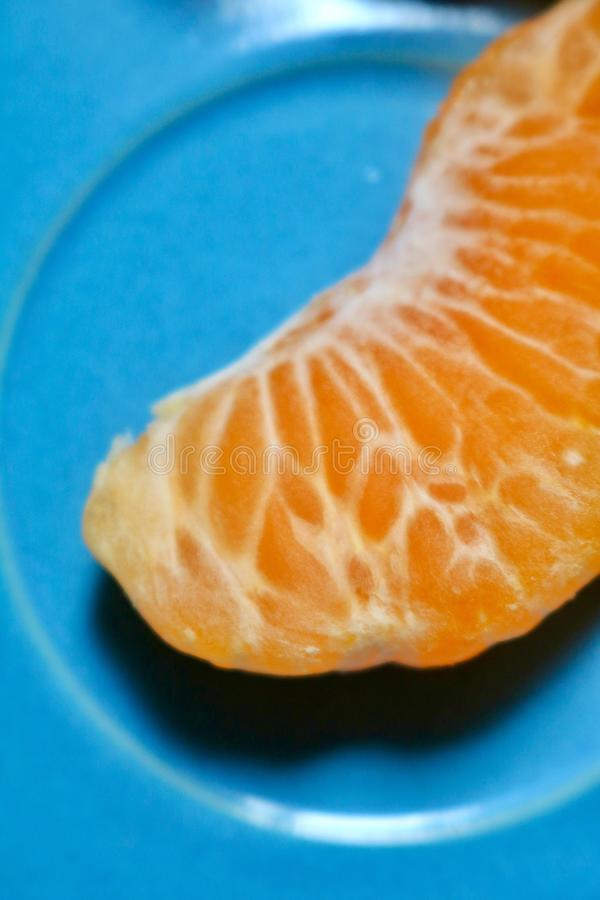 Clementine. Zoom and a blue plate with details stock images