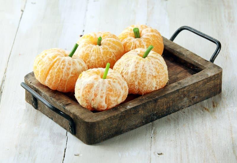 Clementine Oranges Decorated Like Pumpkins royaltyfria bilder