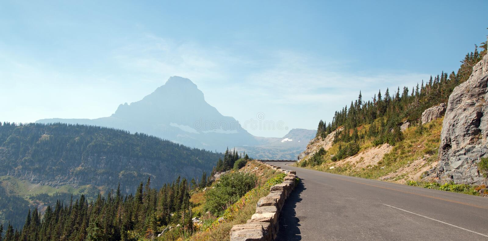 CLEMENTS MOUNTAIN AT THE TOP OF LOGAN PASS ON THE GOING TO THE SUN HIGHWAY UNDER CIRRUS CLOUDS IN GLACIER NATIONAL PARK USA. CLEMENTS MOUNTAIN AT THE TOP OF royalty free stock photography