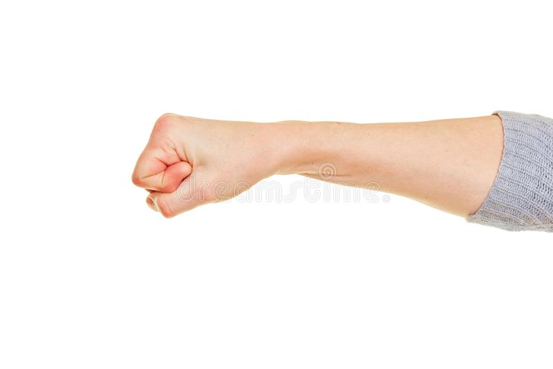 Clenched female fist isolated against background. Clenched female fist isolated against a white background stock image