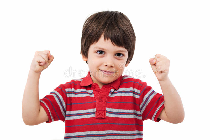 Clenched fists winning. Child with clenched fists winning, studio shot royalty free stock photo
