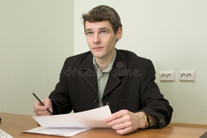 Clerk at office sits at a desktop royalty free stock photo