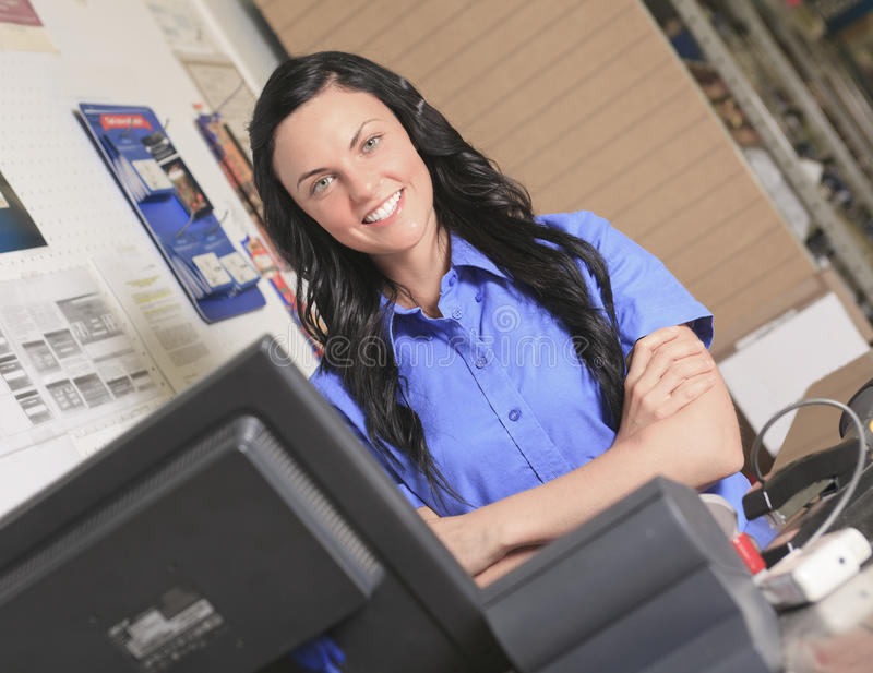 Clerk portrait in home appliance shop supermarket royalty free stock image