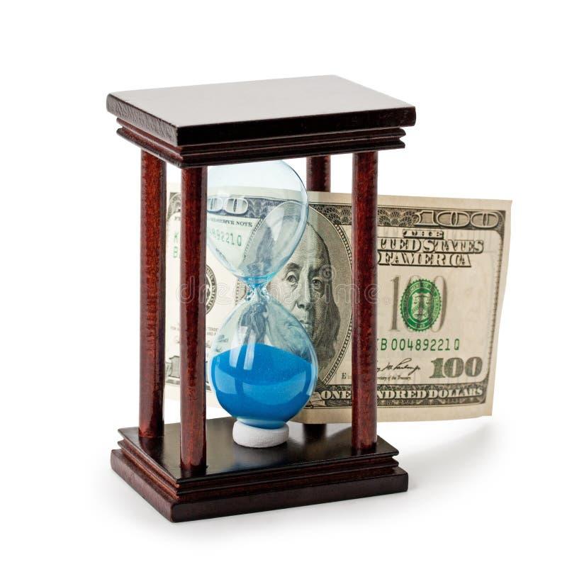 Clessidra e soldi fotografia stock